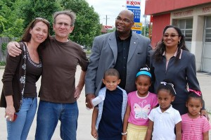 Suzi & Kip Petroff standing outside the abandoned Exxon Jiffy Lube that is now the Empowerment Center.  Pictured here in 2006 along with Director Johnny Flowers and his family.